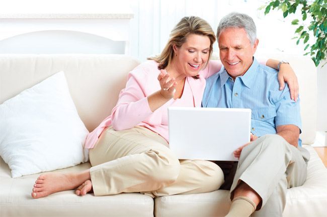 Couple on laptop looking at patient portal photo